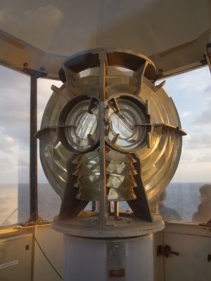The lens which still provides navigational aid to ships passing along. The lighthouse was originally built in 1863 and rebuilt in 1931.